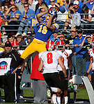 BROOKINGS, SD - OCTOBER 25:  Jake Wieneke #19 from South Dakota State University leaps to make a catch over Donald D'Aleiso #8 from Youngstown State in the third quarter of their game Saturday afternoon at Coughlin Alumni Stadium in Brookings. (Photo by Dave Eggen/Inertia)