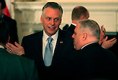 """Governor Terence Richard """"Terry"""" McAuliffe (Democrat of Virginia) and Governor Larry Hogan (Republican of Maryland) talk prior to United States President Barack Obama delivering remarks and taking questions from the National Governors Association in the State Dining Room of the White House in Washington, DC on February 22,2016.<br /> Credit: Dennis Brack / Pool via CNP"""