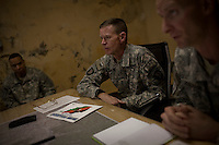 US Army General Schloesser in the Blessing Command Centre during a visit to bases in the Pesh and Korengal Valley, epicentre of the war and scene of fierce fighting with the Taliban. He came to Blessing for an urgent briefing on recent activity.