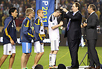 20 November 2011: MLS CEO Mark Abbott (2nd from right) places a winners medal around the neck of Los Angeles' Robbie Keane (IRL) as MLS executive Todd Durbin (right) holds the next medal and Keane's teammates (left) wait for their turn. The Los Angeles Galaxy defeated the Houston Dynamo 1-0 at the Home Depot Center in Carson, CA in MLS Cup 2011, Major League Soccer's championship game.