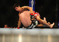 Oct. 29, 2011; Las Vegas, NV, USA; UFC fighter Hatsu Hioki (top) against George Roop during UFC 137 at the Mandalay Bay event center. Mandatory Credit: Mark J. Rebilas-