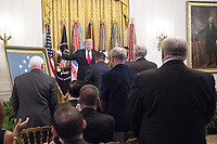 United States President Donald J. Trump acknowledges the attendance of many Congressional Medal of Honor recipients as he makes remarks at the Congressional Medal of Honor Society Reception in the East Room of the White House in Washington, DC on Wednesday, September 12, 2018.<br /> CAP/MPI/RS<br /> &copy;RS/MPI/Capital Pictures