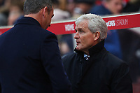 Swansea City manager Paul Clement shakes hands with Stoke City manager Mark Hughes prior to kick off of the Premier League match between Stoke City and Swansea City at the bet365 Stadium, Stoke on Trent, England, UK. Saturday 02 December 2017