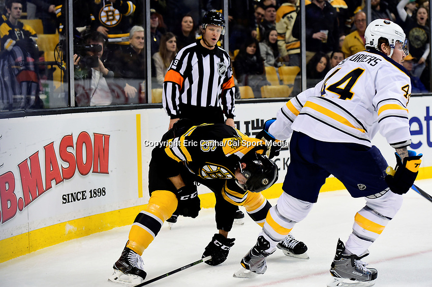 Saturday, December 31, 2016: Buffalo Sabres left wing Nicolas Deslauriers (44) holds Boston Bruins defenseman Colin Miller (6) by the sweater during the National Hockey League game between the Buffalo Sabres and the Boston Bruins held at TD Garden, in Boston, Mass. Boston defeats Buffalo 3-1.  Eric Canha/CSM