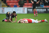 Fleetwood Town's Paddy Madden lies prostrate after a high foot from Peterborough United's Nathan Thompson (left) <br /> <br /> Photographer Kevin Barnes/CameraSport<br /> <br /> The EFL Sky Bet League One - Fleetwood Town v Peterborough United - Saturday 15th February 2020 - Highbury Stadium - Fleetwood<br /> <br /> World Copyright © 2020 CameraSport. All rights reserved. 43 Linden Ave. Countesthorpe. Leicester. England. LE8 5PG - Tel: +44 (0) 116 277 4147 - admin@camerasport.com - www.camerasport.com
