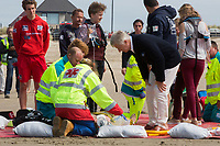 Le roi Philippe de Belgique, la reine Mathilde de Belgique, leurs enfants ; la Princesse Elisabeth, le Prince Gabriel, le Prince Emmanuel et la Princesse El&eacute;onore assistent &agrave; une d&eacute;monstration des services de sauvetage sur la plage de Middelkerke. <br /> La princesse Elisabeth a elle-m&ecirc;me particip&eacute; &agrave; la r&eacute;animation.<br /> Belgique, Middelkerke, 1er juillet 2017.<br /> King Philippe of Belgium, Queen Mathilde of Belgium and their children, Crown Princess Elisabeth, Prince Emmanuel, Prince Gabriel, and Princess Eleonore of Belgium pictured during a rescue exercice, part of a visit of Belgian royal couple at the Belgian coast, in Westende, Middelkerke.<br />  Belgium, Westende, Middelkerke, 01 July 2017.<br /> Pic :  King Philippe of Belgium &amp; Prince Gabriel of Belgium
