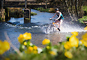 19/04/18<br /> <br /> On the hottest day of the year, Chloé Kirkpatrick, 25, cools off as she rides her bicycle across Tissington ford near Ashbourne in the Derbyshire Peak District.<br /> <br /> All Rights Reserved: F Stop Press Ltd. +44(0)1335 344240  www.fstoppress.com.