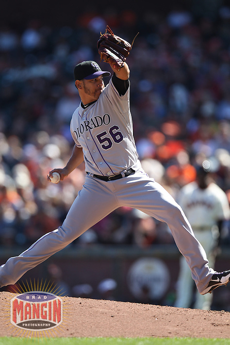 SAN FRANCISCO - SEPTEMBER 20:  Guillermo Moscoso of the Colorado Rockies pitches during the game against the San Francisco Giants at AT&T Park on September 20, 2012 in San Francisco, California. (Photo by Brad Mangin)