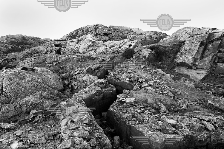 A defensive trench used by the German Army in WWII are visible along a rocky coast in Norway along the route of the Atlantic Wall (Atlantikwall in German).The Atlantic Wall (or Atlantikwall in German) was a system of defensive structures built by Nazi Germany between 1942 and 1945, stretching over 1,670 miles (2,690 km) along the coast from the North of Norway to the border between France and Spain at the Pyrenees. The wall was intended to repulse an Allied attack on Nazi-occupied Europe and the largest concentration of structures was along the French coast since an invasion from Great Britain was assumed to be most likely. Slave labour and locals paid a minimum wage were drafted in to supply much of the labour. There are still thousands of ruined structures along the Atlantic coast in all countries where the wall stood except for Germany, where the bunkers were completely dismantled.