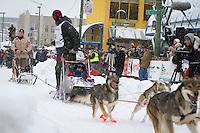 William Pinkham leaves the 2011 Iditarod ceremonial start line in downtown Anchorage, during the 2012 Iditarod..Jim R. Kohl/Iditarodphotos.com