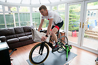 April 30th 2020, NEWCASTLE-UNDER-LYME, United Kingdom; British triathlete Lloyd Bebbington trains at home in his garden because of the coronavirus lockdown restrictions in Newcastle-under-Lyme