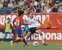 USWNT substitute midfielder Morgan Brian (25) controls the ball as Korea Republic substitute midfielder Lee Mina (13) closes. In an international friendly, the U.S. Women's National Team (USWNT) (white/blue) defeated Korea Republic (South Korea) (red/blue), 4-1, at Gillette Stadium on June 15, 2013.