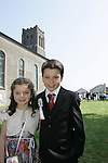 Dylan Grendon, who made his First Communion in Sandpit on Saturday, pictured with his sister Kellie.