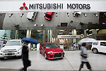 April 26, 2012, Tokyo, Japan - Pedestrians walk past the Mitsubishi Motors Corp headquarters. Japan's Mitsubishi Motors posted a 53% net profit increase for fiscal year to March which is partly due to the company's cost cutting plan. As Japan's fourth-largest automaker, the company earned 23.9 billion Japanese yen ($294 million) in the past year, which is up from 15.6 billion Japanese yen in the previous period. (Photo by Christopher Jue/AFLO)