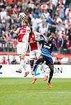 Nederland, Amsterdam, 30 maart 2014<br /> Eredivisie<br /> Seizoen 2013-2014<br /> Ajax-FC Twente<br /> Daley Blind (l.) van Ajax, Stefano Denswil (m.) en Quincy Promes (r.) van FC Twente strijden in een kopduel om de bal.