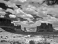Courthouse Towers and road with clouds. Arches National Park, Utah