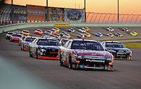 Nov. 16, 2008; Homestead, FL, USA; NASCAR Sprint Cup Series driver Carl Edwards (99) leads the field during the Ford 400 at Homestead Miami Speedway. Mandatory Credit: Mark J. Rebilas-