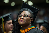 Delphine Atu-Tetuh, NURS MS, during the UAA Spring 2018 Graduate Degree Hooding Ceremony.UAA Spring 2018 Commencement at the Alaska Airlines Center.