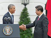 United States President Barack Obama and President XI Jinping of China shake hands after the President concluded his remarks welcoming the Chinese leader during an official State Arrival ceremony on the South Lawn of the White House in Washington, DC on Friday, September 25, 2015.<br /> Credit: Ron Sachs / CNP