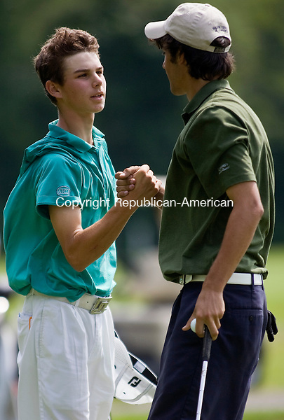 WATERTOWN--18 July 08--071808TJ02 - Blake Morris, left, of the Country Club of Waterbury, congratulates his opponent Michael McCarthy, of Twin Hills in Tolland, at the 15th hole after McCarthy won the Connecticut Junior Amateur Championship by four holes with three remaining, at the Watertown Golf Club, on Friday, July 18, 2008. (T.J. Kirkpatrick/Republican-American)