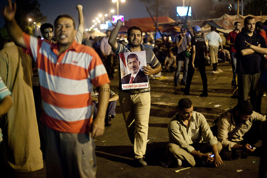 Supporter of Mohammed Morsi show their anger and sadness after Abdel-Fattah El-Sisi's speech that ended Morsi's presidency in Nasr City, Cairo, Wednesday, July 3, 2013. Egyptian President Mohammed Morsi has been officially dismissed from his Presidency after Chief of Egyptian armed forces, Abdel-Fattah El-Sisi's speech specified that the constitution will be suspended temporarily; the head of the High Constitutional Court will take over the presidency and will have power until early presidential elections.<br /> <br /> Des supporters de Mohammed Morsi montrent leur colere et leur tristesse apres le discours d'Abdel-Fattah El-Sisi qui annoncait la fin de la presidence de Morsi a Nasr City, Le Caire, le mercredi 3 Juillet 2013. Le president egyptien Mohammed Morsi a ete officiellement demis de sa presidence apres que le chef des forces egyptiennes Abdel-Fattah El-Sisi ait annonce que la constitution sera temporairement suspendu et que la tete de la Haute Cour Constitutionnelle vprendra la presidence jusqu'aux elecctions presidentielles anticipees.