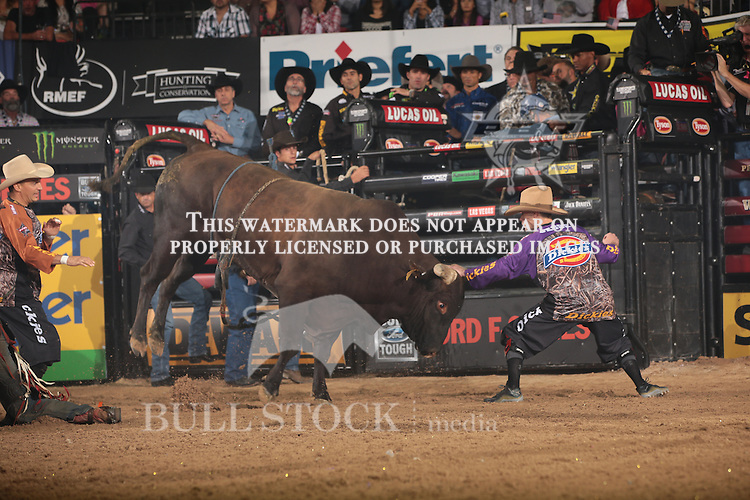 Tanner Byrne attempts to ride McConnell's Missouri Boat Ride and Jesse Byrne steps in during the fourth round of the World Finals Built Ford Tough Series PBR. Photo by Andy Watson