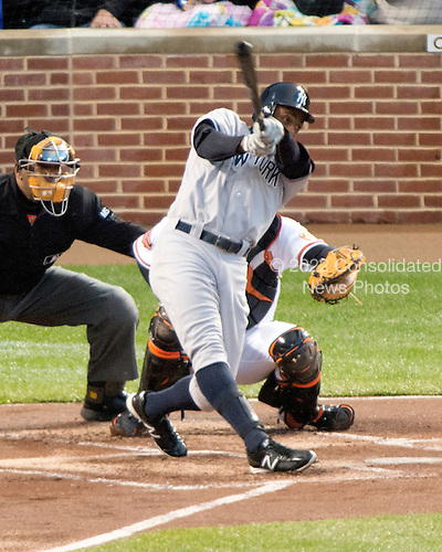 New York Yankees centerfielder Curtis Granderson (14) connects for a 2 run home run in the first inning against the Baltimore Orioles at Oriole Park at Camden Yards in Baltimore, MD on Thursday, April 11, 2012.  .Credit: Ron Sachs / CNP.(RESTRICTION: NO New York or New Jersey Newspapers or newspapers within a 75 mile radius of New York City)