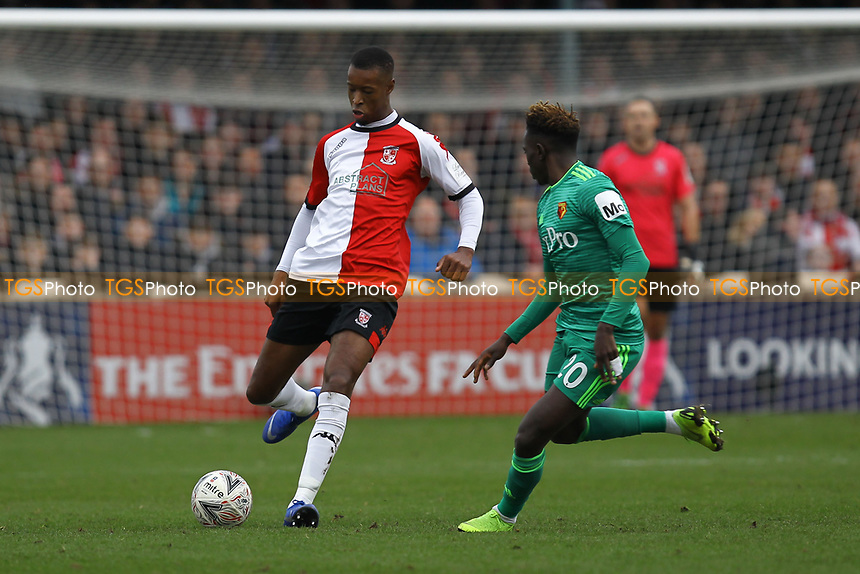 Nathen Colier of Woking and Domingos Quina of Watford during Woking vs Watford, Emirates FA Cup Football at The Laithwaite Community Stadium on 6th January 2019