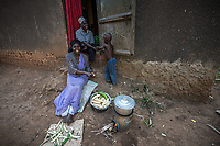 Uganda, Angi. Nabiirah SserKumba (29) and her husband Hakim have seven children. She uses the BioLite stove as it's faster and emits less smoke. It also charges a lite, portable radio and her mobile phone. Cookig with her husband Hakim and son Jawaduh (5).