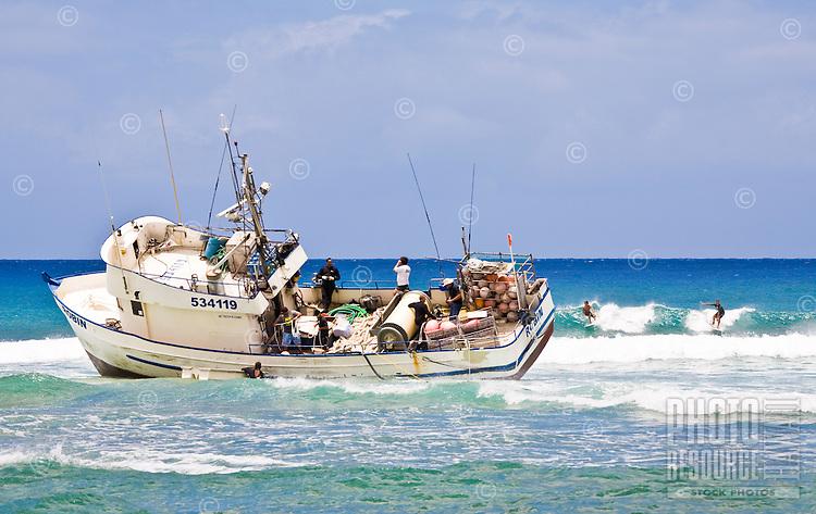 Fishing boat gone aground on the reef near Ala Wai Harbor