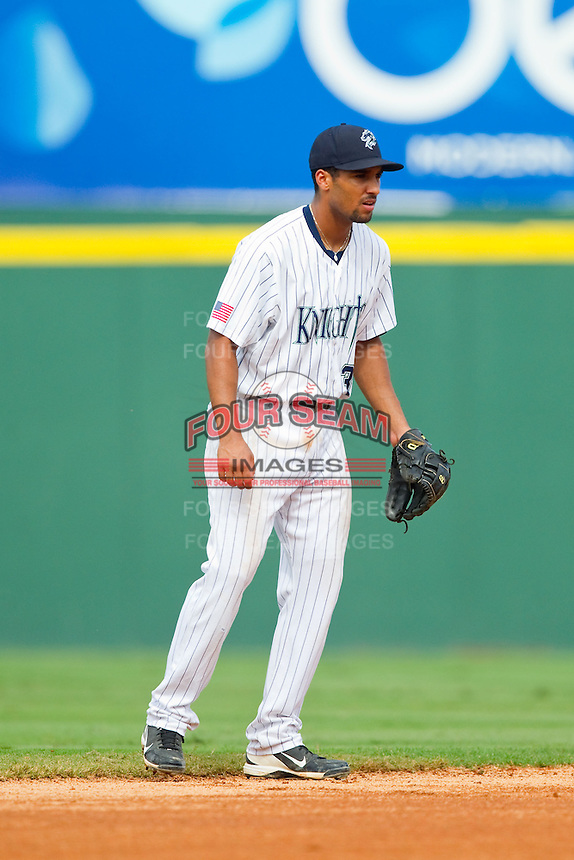 Charlotte Knights shortstop Marcus Semien (3) on defense against the Durham Bulls at Knights Stadium on August 18, 2013 in Fort Mill, South Carolina.  The Bulls defeated the Knights 5-1 in Game Two of a double-header.  (Brian Westerholt/Four Seam Images)