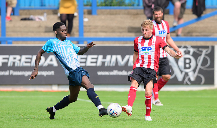 Lincoln City's Joe Morrell vies for possession with Gainsborough Trinity's Rod Orlando Young<br /> <br /> Photographer Chris Vaughan/CameraSport<br /> <br /> Football Pre-Season Friendly (Community Festival of Lincolnshire) - Gainsborough Trinity v Lincoln City - Saturday 6th July 2019 - The Martin & Co Arena - Gainsborough<br /> <br /> World Copyright © 2018 CameraSport. All rights reserved. 43 Linden Ave. Countesthorpe. Leicester. England. LE8 5PG - Tel: +44 (0) 116 277 4147 - admin@camerasport.com - www.camerasport.com