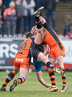 Picture by Allan McKenzie/SWpix.com - 11/03/2018 - Rugby League - Betfred Super League - Castleford Tigers v Salford Red Devils - the Mend A Hose Jungle, Castleford, England - Castleford's Oliver Holmes upends Salford's Luke Burgess.