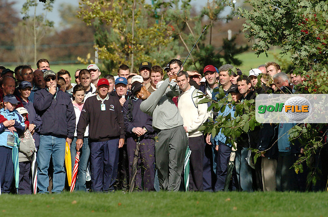 THOMASTOWN, IRELAND. Tiger Woods  USA playing his second shot from within the crowd after hooking his tee shot on the second fairway during the American Express Championship day three at the Mount Juliet Golf Club on October 2nd, 2004 in Thomastown, Ireland ..Photo AFP/NEWSFILE/FRAN CAFFREY..(Photo credit should read FRAN CAFFREY/NEWSFILE/AFP)...This Picture has been sent you under the condtions enclosed by:.Newsfile Ltd..the Studio,.Millmount Abbey,.Drogheda,.Co Meath..Ireland..Tel: +353(0)41-9871240.Fax: +353(0)41-9871260.GSM: +353(0)86-2500958.email: pictures@newsfile.ie.www.newsfile.ie.FTP: 193.120.102.198..This picture is from Fran Caffrey@newsfile.ie
