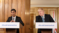 17/03/2020 - Chancellor Rishi Sunak, left, looks as British Prime Minister Boris Johnson gestures during a press conference about the ongoing situation with the COVID-19 coronavirus outbreak inside 10 Downing Street in London. For most people, the new coronavirus causes only mild or moderate symptoms, such as fever and cough. For some, especially older adults and people with existing health problems, it can cause more severe illness, including pneumonia. Photo Credit: ALPR/AdMedia