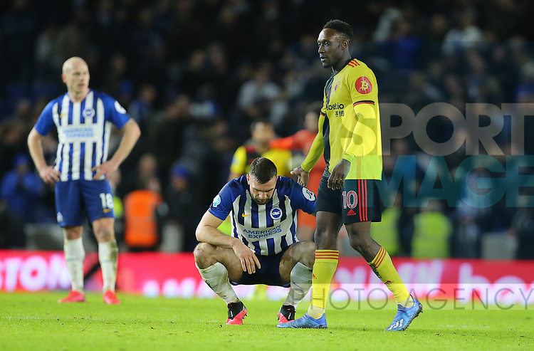 Brighton's Shane Duffy looks dejected as Watford's Danny Welbeck goes to shake his hand after the Premier League match at the American Express Community Stadium, Brighton and Hove. Picture date: 8th February 2020. Picture credit should read: Paul Terry/Sportimage