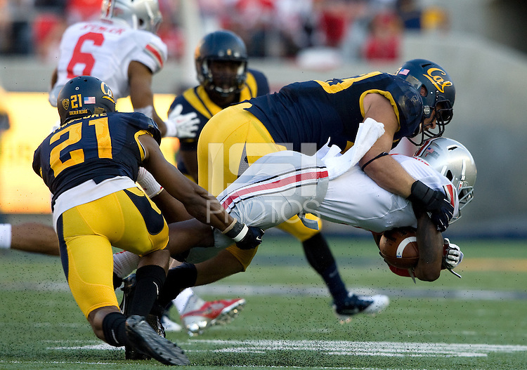 Kyle Kragen of California tackles Ohio State running back during the game at Memorial Stadium in Berkeley, California on September 14th, 2013.  Ohio State defeated California, 52-34.