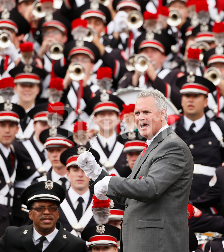 "Russel C. Mikkelson, director of university bands, leads the Ohio State University Marching Band in the playing of ""Carmen, Ohio"" following Saturday's NCAA Division I football game at M&T Bank Stadium in Baltimore on August 30, 2014. Ohio State won the game with a final score of 34-17. (Dispatch Photo by Barbara J. Perenic)"