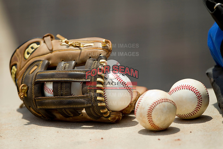 Baseballs and a glove sit in the dugout during the game between PONY and Dixie at the 2011 Tournament of Stars at the USA Baseball National Training Center on June 26, 2011 in Cary, North Carolina.  PONY defeated Dixie 4-3. (Brian Westerholt/Four Seam Images)