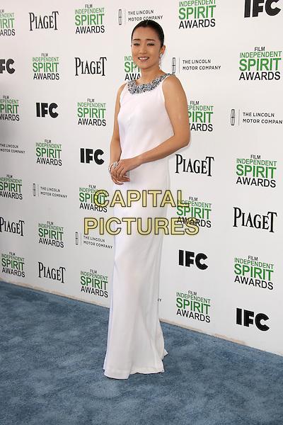 SANTA MONICA, CA - March 01: Gong Li at the 2014 Film Independent Spirit Awards Arrivals, Santa Monica Beach, Santa Monica,  March 01, 2014. Credit: Janice Ogata/MediaPunch<br /> CAP/MPI/JO<br /> &copy;JO/MPI/Capital Pictures
