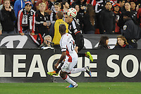 Washington, D.C.- March 29, 2014. Fabian Espindola (9) of D.C. United heads the ball against Jose Goncalves (23) of the New England Revolution.  D.C. United defeated the New England Revolution 2-0 during a Major League Soccer Match for the 2014 season at RFK Stadium.