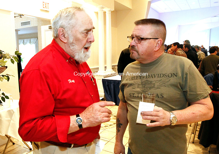 Southington, CT- 21 March 2014-032114CM07- Ray Hanley, left, Chairman of the Nutmeg Chapter of the Friends of the NRA chats with Bob Voghel, head range officer at the Wolcott Land Owners Protective Association, during the 22nd Annual Nutmeg Friends of the National Rifle Association banquet at the Aqua Turf Friday night in Southington. Hundreds of attendees packed the banquet hall, an event to raise money for the promotion of gun safety and the preservation of the Second Amendment.   Christopher Massa Republican-American