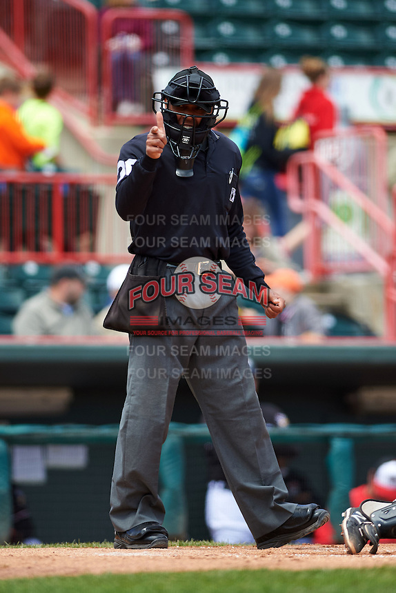 Umpire Jeremie Rehak makes a call during a game between the Richmond Flying Squirrels and Erie Seawolves on May 20, 2015 at Jerry Uht Park in Erie, Pennsylvania.  Erie defeated Richmond 5-2.  (Mike Janes/Four Seam Images)