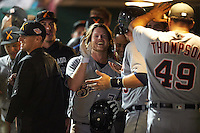 Salt River Rafters Brett Phillips (7), of the Milwaukee Brewers organization, high fives teammates after scoring a run during a game against the Scottsdale Scorpions on October 12, 2016 at Scottsdale Stadium in Scottsdale, Arizona.  Salt River defeated Scottsdale 6-4.  (Mike Janes/Four Seam Images)