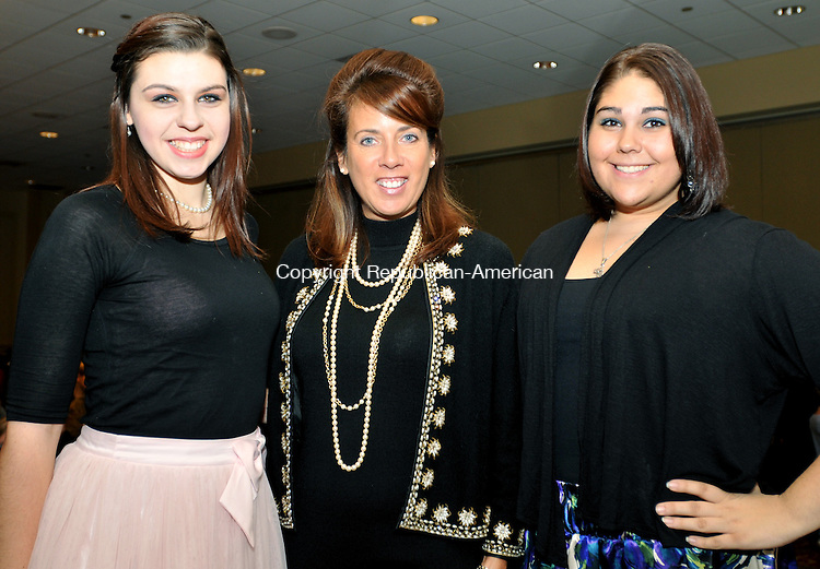 WATERBURY, CT, 10 NOVEMBER 2011-111211JS10-Event emcees from left, K'Ehleyr Smith, 17 of Waterbury, Lynnette Letsky-Piombo and Nicole Lopez, 16, of Wolcott during the American Girl fashion show held at the Coco Key Water Resort in Waterbury. Based upon the American Girl book and doll series, the program showcased historical and contemporary fashions for girls and their dolls. Proceeds from the event will benefit children's educational programs at the Mattatuck Museum in Waterbury.<br />  Jim Shannon Republican-American