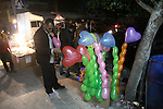 A Palestinian vendor sells balloons, during take part in celebrations of the New Year's Eve festivities in the Gaza city of on Dec. 31, 2012. Photo by Ezz al-Zanoon