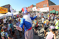 "Dressed as a stilted Uncle Sam, Tom Lawler of Parkersburg welcomes riders to Parkersburg Thursday morning.  ""Wecome to Parkersburg!  RAGBRAI is a celebration of America!"" he exclaimed."