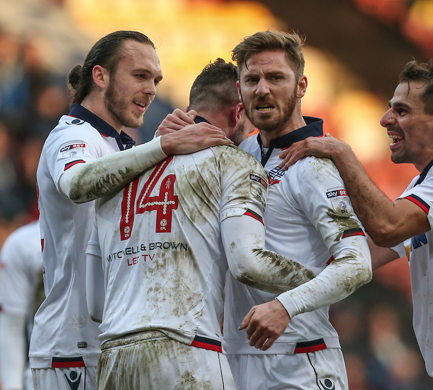 Bolton Wanderers' Gary Madine celebrates scoring his sides second goal with teammates James Henry and Tom Thorpe<br /> <br /> Photographer Alex Dodd/CameraSport<br /> <br /> The EFL Sky Bet League One - Bradford City v Bolton Wanderers  - Saturday 18th February 2017 - Coral Windows Stadium - Bradford<br /> <br /> World Copyright &copy; 2017 CameraSport. All rights reserved. 43 Linden Ave. Countesthorpe. Leicester. England. LE8 5PG - Tel: +44 (0) 116 277 4147 - admin@camerasport.com - www.camerasport.com