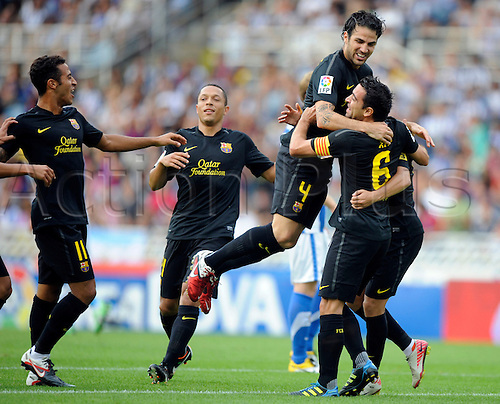 09.10.2011. Real Sociedad, Spain.  Real Sociedad vs Barcelona   Picture show Barcelona players celebrate their first goal.