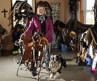 NWA Democrat-Gazette/ANDY SHUPE<br /> Marsha Wyatt, owner of Windsong Ranch near Greenland, poses Wednesday, Jan. 4, 2016, in her favorite space, the tack room at her home at her ranch. Wyatt works with horses and trains service dogs for veterans.